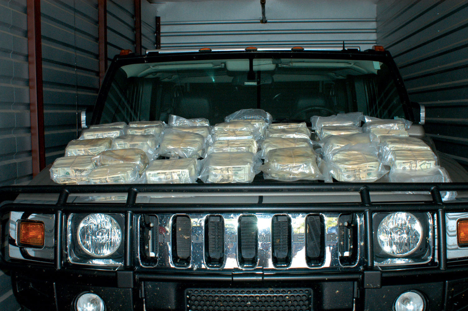 Authorities found hundreds of thousands of dollars hidden inside a Hummer that was driven to Atlanta and locked in a storage unit.